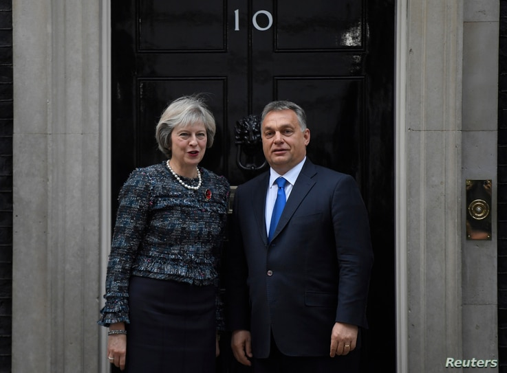 Britain's Prime Minister Theresa May greets Hungary's Prime Minister Viktor Orban at Downing Street in London, Nov. 9, 2016.