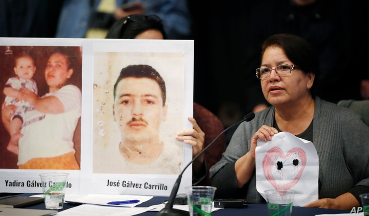 Irma Carrillo of Phoenix holds up a hand-drawn picture of her heart with two holes in it for her two children who have been missing since 1999, as she speaks during a hearing held by the Inter-American Commission on Human Rights, Oct. 5, 2018, at the...