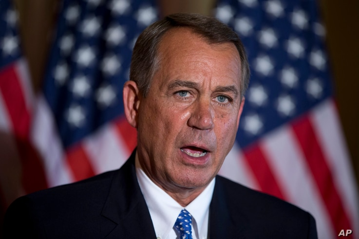 House Speaker John Boehner of Ohio speaks about the ongoing budget battle, Oct. 8, 2013, outside his office on Capitol Hill in Washington.