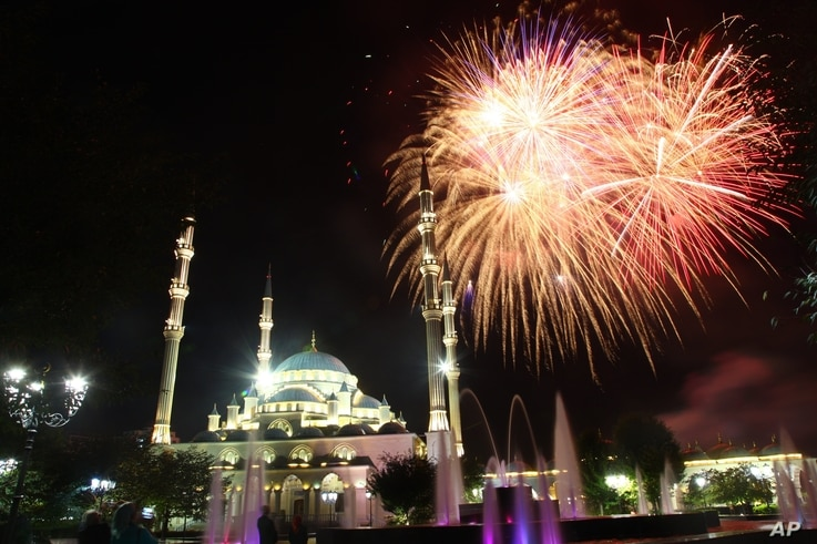 Fireworks illuminate the sky at the 'Heart of Chechnya' mosque to mark national election day in Chechnya's provincial capital Grozny, Russia, Sept. 18, 2016.
