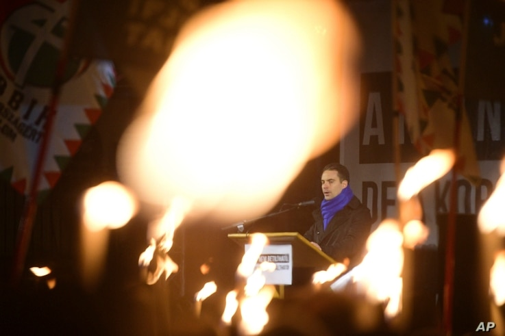 Chairman of opposition Jobbik party of Hungary Gabor Vona delivers his speech during the party's anti-government protest held at the headquarters of Fidesz, the Hungarian Civic Party in Budapest, Hungary, Dec. 15, 2017.