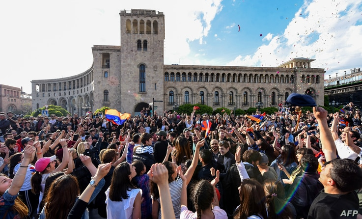 People celebrate Armenian prime minister Serzh Sarkisian's resignation in downtown Yerevan on April 23, 2018. Armenia's veteran leader Serzh Sarkisian resigned on April 23, 2018 after mass protests against his election as prime minister, sparking jub...
