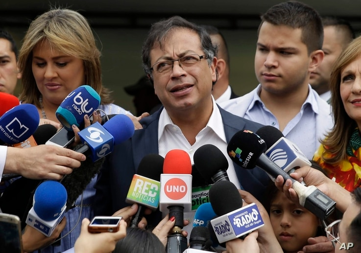 Gustavo Petro, presidential candidate for Colombia Humana, talks with the press after casting his ballot during the presidential election in Bogota, Colombia, June 17, 2018.