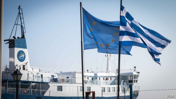 At the water's edge on Chios port. Fractured relations from EU down to the Greek government and the local authorities on Chios have exacerbated the issues. (J. Owens for VOA)