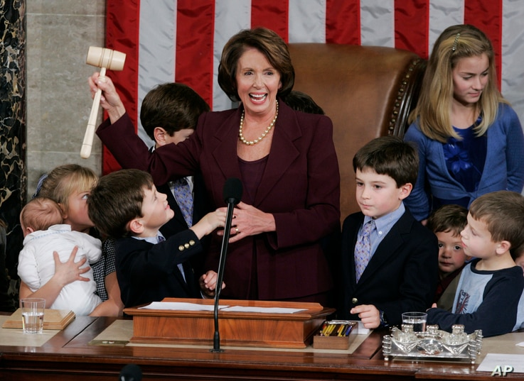 Newly elected Speaker of the House Nancy Pelosi, holds up the gavel surrounded by children and grandchildren of members of Congress in the U.S. Capitol in Washington Thursday, Jan. 4, 2007. (AP Photo/Pablo Martinez Monsivais)