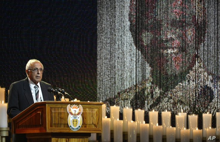 FILE - In this Dec. 15, 2013 file photo, anti-apartheid activist and close friend of Nelson Mandela, Ahmed Kathrada, speaks during the funeral service for the former South African president in Qunu, South Africa.