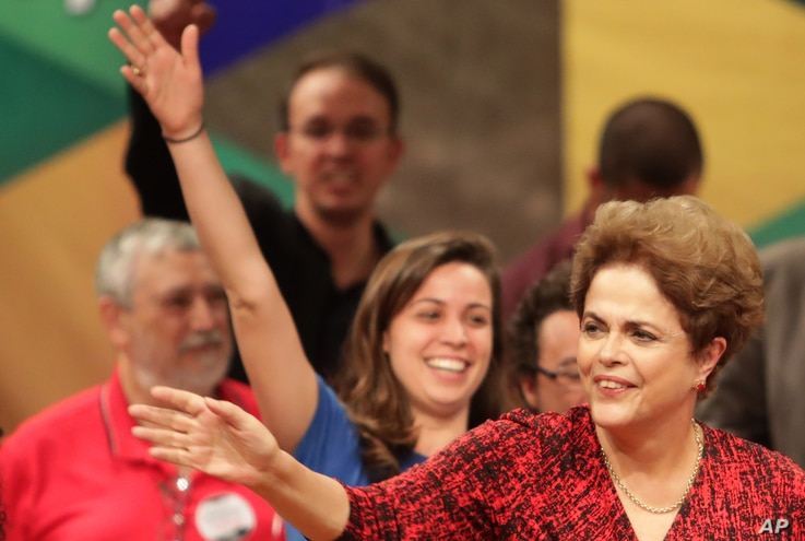 Brazil's suspended President Dilma Rousseff arrives at a rally in Brasilia, Brazil, Aug. 24, 2016.