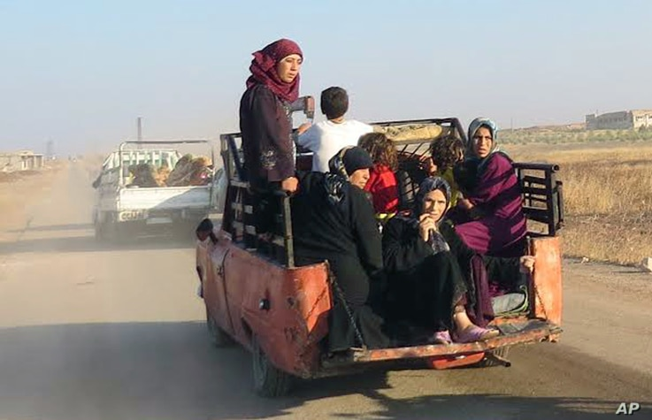 This photo provided by the Syria Press Center (SPC), an anti-government media group, shows civilians leaving the town of Suran, in Hama province, Sept. 1, 2016.