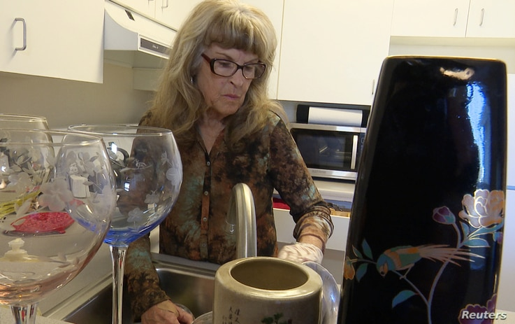 Gayle McCormick works in her kitchen in this still photo taken from video, inside her new apartment in Bellingham, Washington, Feb. 2, 2017.