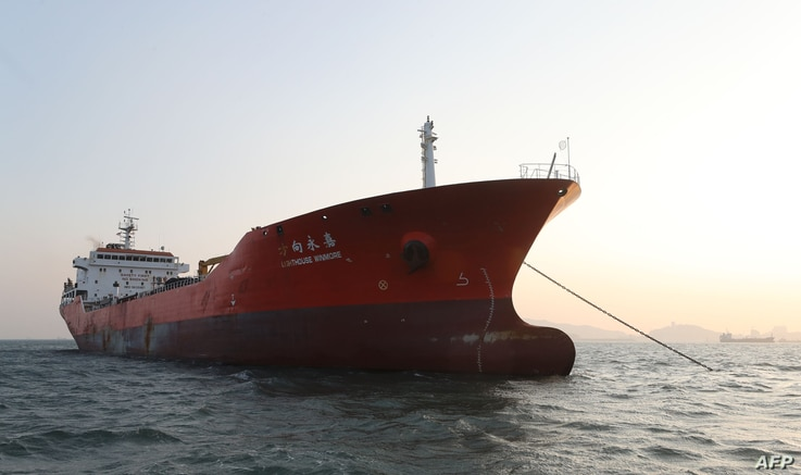 The Lighthouse Winmore, chartered by Taiwanese company Billions Bunker Group Corp., is seen at sea off South Korea's Yeosu port, Dec. 29, 2017. South Korea briefly seized and inspected a Hong Kong-registered ship in November for transferring oil prod