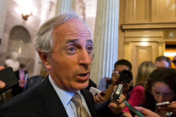 Sen. Bob Corker speaks with reporters after the immigration bill got more than 60 needed votes to advance in the Senate, at the Capitol in Washington, June 24, 2013.
