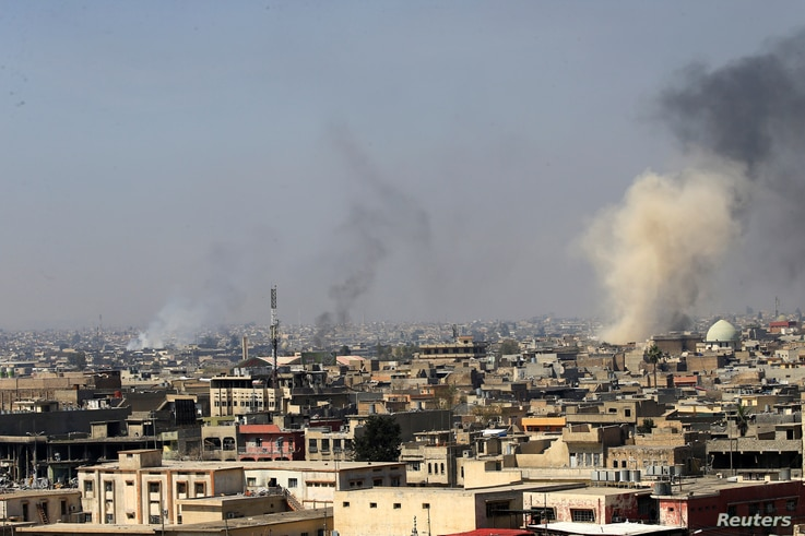 Smoke rises from the old city during a battle against Islamic State militants, in Mosul, Iraq, March 26, 2017.