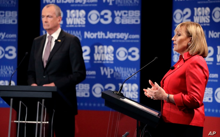 Republican nominee Lt. Gov. Kim Guadagno, right, answers a question during a gubernatorial debate against Democratic nominee Phil Murphy at William Paterson University, Oct. 18, 2017, in Wayne, N.J.