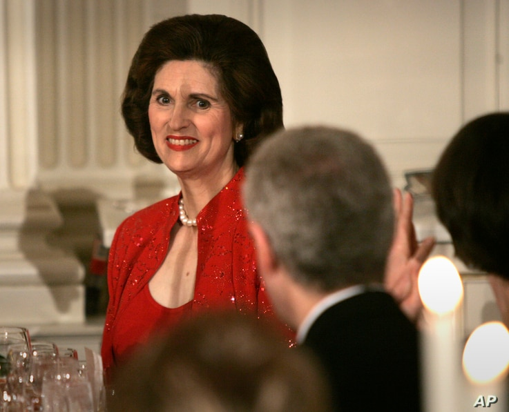 FILE - Linda Robb is recognized by then-President George W. Bush during a toast at a dinner celebrating the 40th anniversary of the National Endowment for the Arts and the National Endowment for the Humanities in the State Dinning Room of the White H...