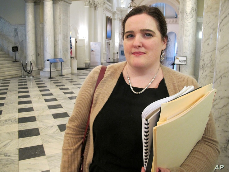 FILE - In this March 19, 2018, photo, Del. Ariana Kelly stands outside the Maryland House of Delegates in Annapolis, Maryland, after the House voted unanimously for her bill to strengthen the General Assembly's policy for handling sexual harassment c...