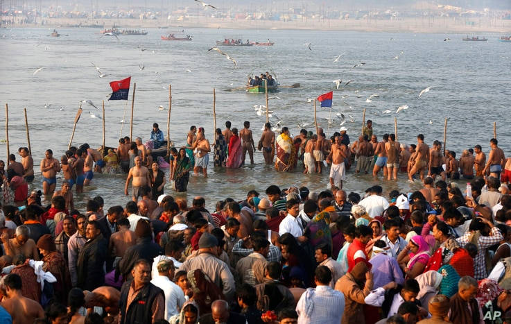 "Indian Hindu devotees gather to take holy dips at Sangam, the confluence of the Rivers Ganges, Yamuna and mythical Saraswati on Maghi Purnima, or the full-moon day of the month during the annual ""Magh Mela"" fair in Allahabad, Feb. 10, 2017."