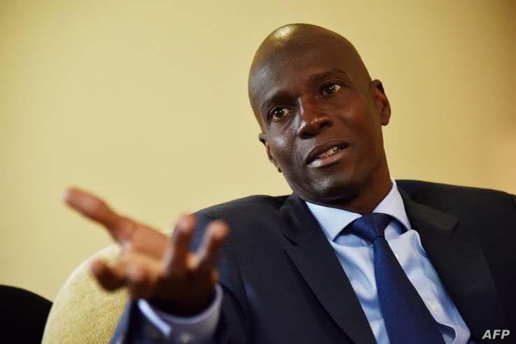 FILE - President Jovenel Moise, then the Haitian presidential candidate of PHTK Political Party, speaks during an interview with AFP in Port-au-Prince, Sept. 6, 2016.