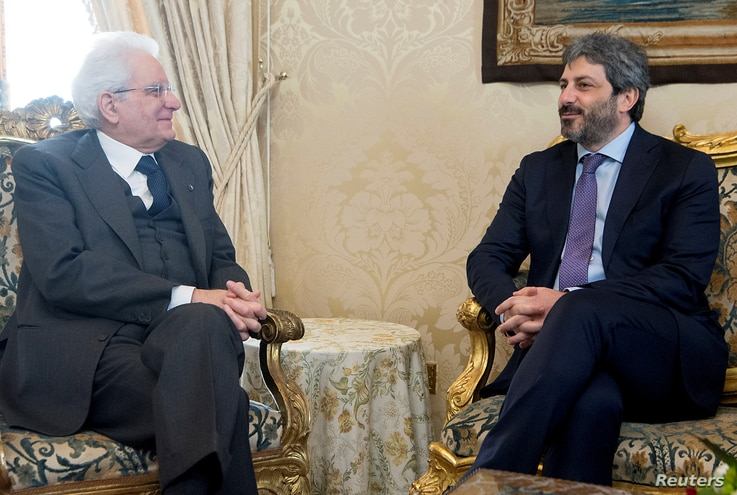 Italian President Sergio Mattarella meets new elected Chamber of Deputies president Roberto Fico at the Quirinale Palace in Rome, March 24, 2018.