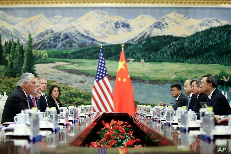U.S. Secretary of State Rex Tillerson, left, meeting with China's State Councilor Yang Jiechi at the Great Hall of the People, Saturday, Sept. 30, 2017, in Beijing, China.