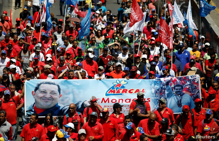 Supporters of Venezuelan President Nicolas Maduro take part in a rally in support of the government in Caracas, April 6, 2019.