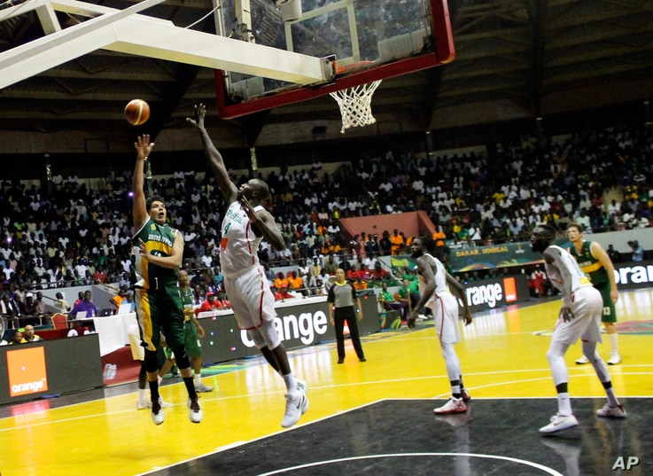 South Africa's Chris Gabriel, left, launches a hook shot during AfroBasket tournament at Marius Ndiaye stadium in Dakar, Senegal, Sept. 8, 2017.
