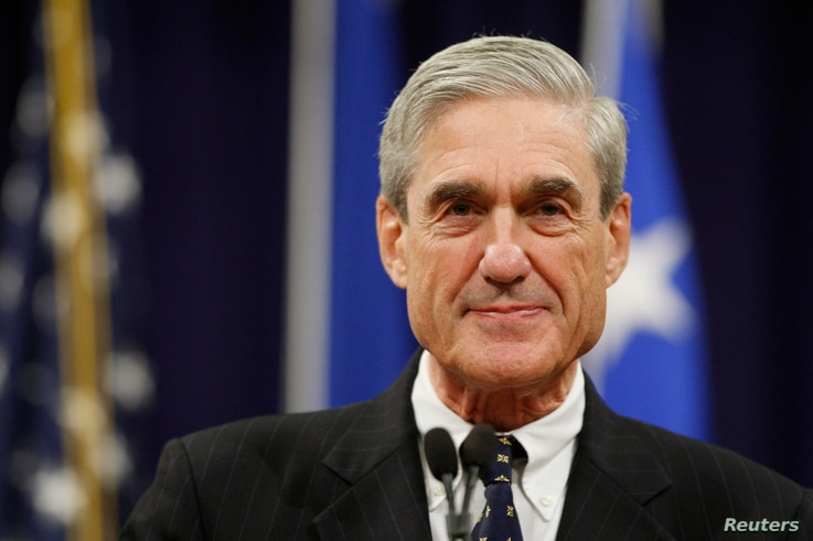 FILE - Outgoing FBI Director Robert Mueller pauses during his remarks at a farewell ceremony held for him at the Justice Department in Washington.