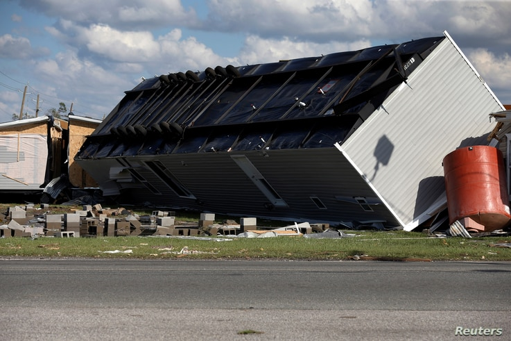 An overturned trailer home damaged by Hurricane Michael is pictured in Springfield, Florida, Oct. 11, 2018.