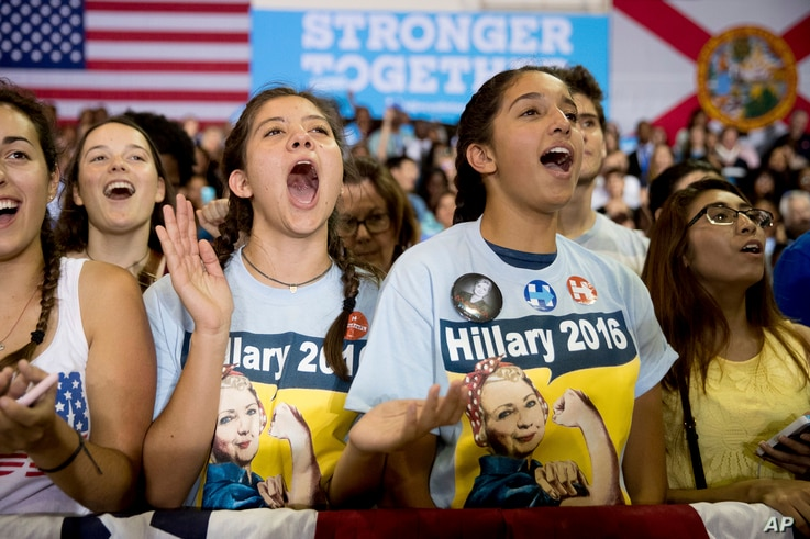 Members of the audience cheer as Democratic presidential candidate Hillary Clinton speaks at a rally at Palm Beach State College in Lake Worth, Florida, Oct. 26, 2016.