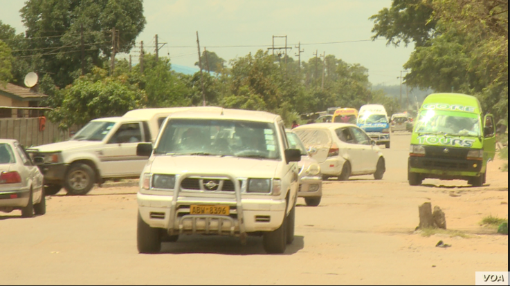 Zimbabwe's roads have become chaotic after years of neglect as motorists try to look for smoother venues for their vehicles, in Harare, Dec. 31, 2018.