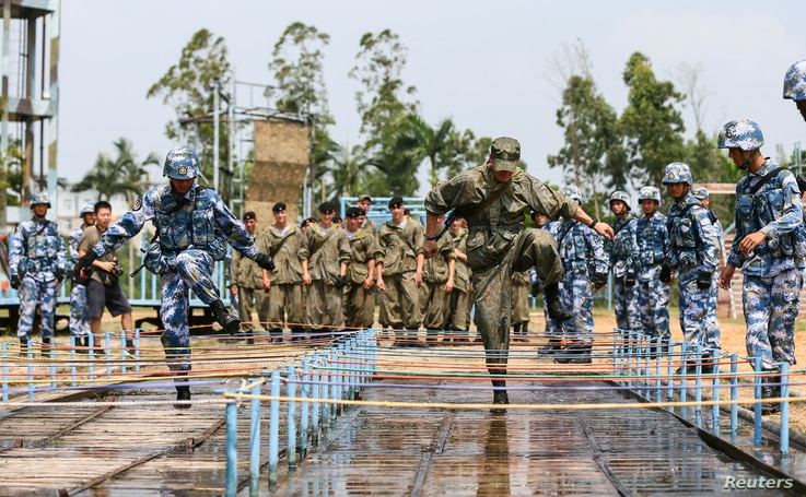 Chinese and Russian soldiers take part in a joint military drill in Zhanjiang, Guangdong province, China, Sept. 13, 2016.
