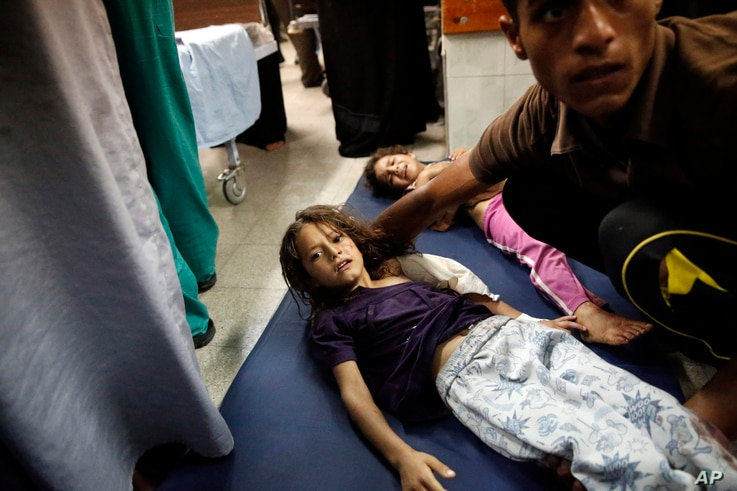 Palestinian children wounded in an Israeli strike on a compound housing a U.N. school in Beit Hanoun in the Gaza Strip lay on the floor of an emergency room in Beit Lahiya, July 24, 2014.