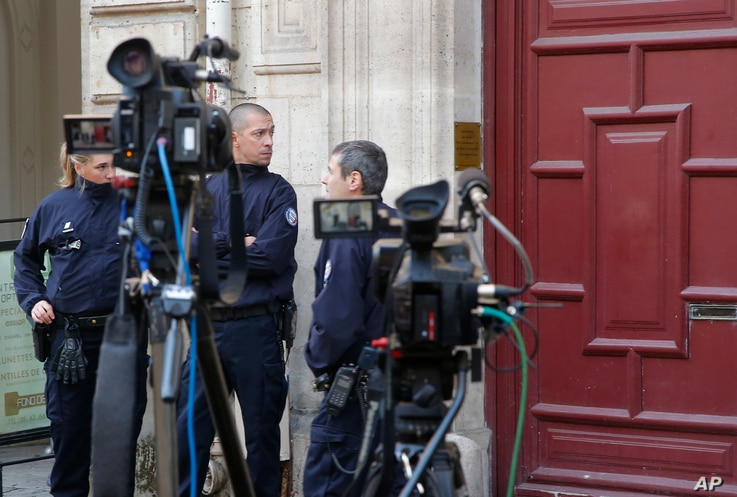 French police officers stand outside the residence of Kim Kardashian West in Paris Monday, Oct. 3, 2016. Kim Kardashian West was unharmed after being robbed at gunpoint of more than $10 million worth of jewelry inside a private Paris residence Sunday...