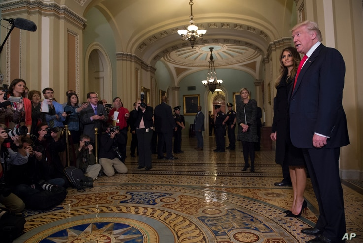President-elect Donald Trump, accompanied by his wife, Melania, speaks to reporters and photographers on Capitol Hill in Washington  after meeting with Senate Majority Leader Mitch McConnell of Kentucky, Nov. 10, 2016.