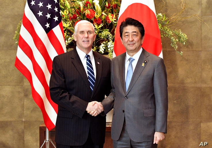 U.S. Vice President Mike Pence, left, shakes hands with Japan's Prime Minister Shinzo Abe upon his arrival at the prime minister's official residence in Tokyo Wednesday, Feb. 7, 2018.