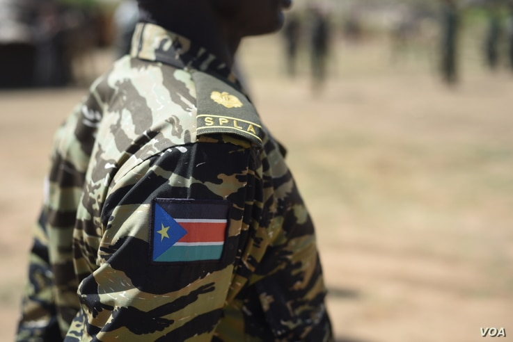 The South Sudanese flag on the uniform of a government soldier at Jebel Makor, 45 minutes outside of South Sudan's capital Juba on April 14 2016. The soldiers were brought here as part of a process to reduce the number of troops in the city before th...