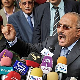 Yemeni President Ali Abdullah Saleh reacts while delivering a speech to his supporters, during a rally in his support in Sana'a, Yemen, May 20, 2011.