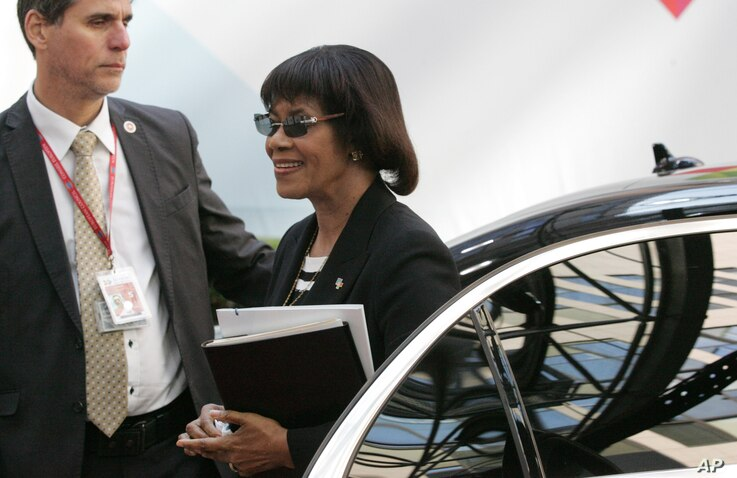 FILE - Jamaica's Prime Minister Portia Simpson Miller, right, arrives for the EU-CELAC summit in Brussels, June 11, 2015.
