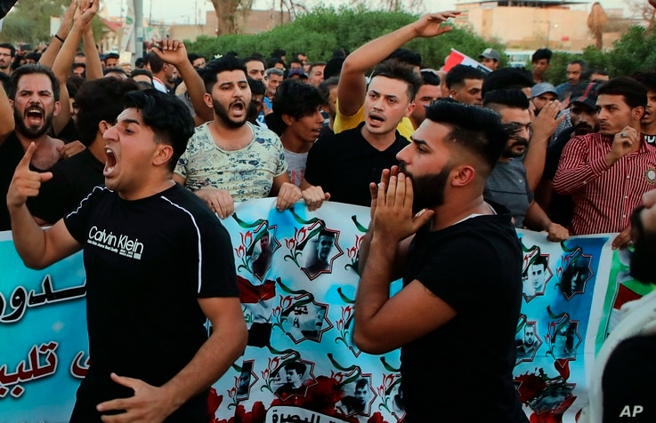 Protesters chant slogans during a demonstration demanding better public services and jobs in Basra, Iraq, Sept. 28, 2018.