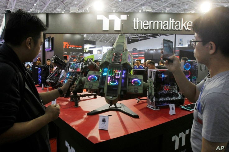 Visitors review Thermaltake's MFC 2 2nd Place MOD during the Computex Taipei, one of the world's largest IT expos, in Taipei, Taiwan, June 5, 2018.
