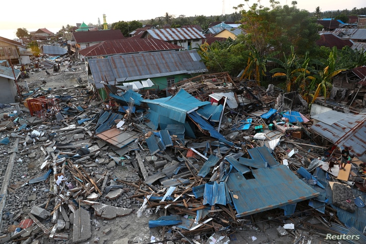 Debris and damaged properties are seen after the earthquake and tsunami hit an area in Wani, Donggala, Central Sulawesi, Indonesia, Oct. 3, 2018.