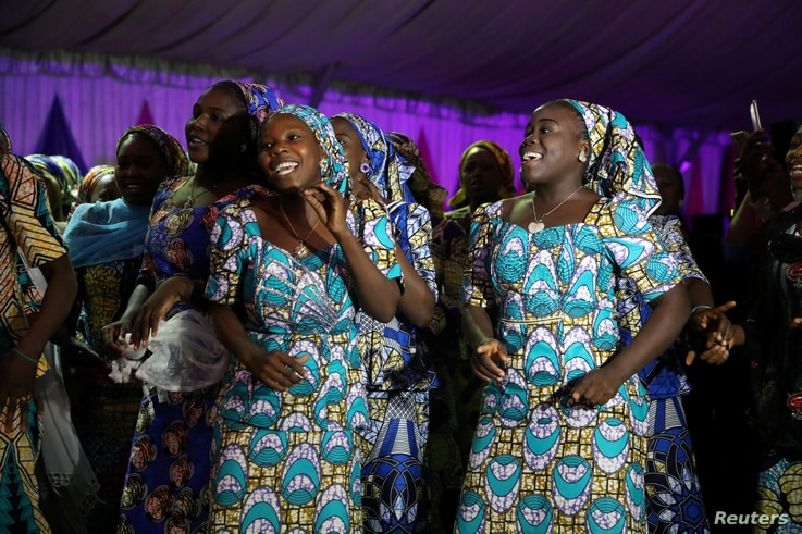 Some of the 106 girls who were kidnapped by Boko Haram militants in the Nigerian town of Chibok, are seen dancing joyfully during the the send-forth dinner organised for them in Abuja, Nigeria, Sept. 13, 2017.
