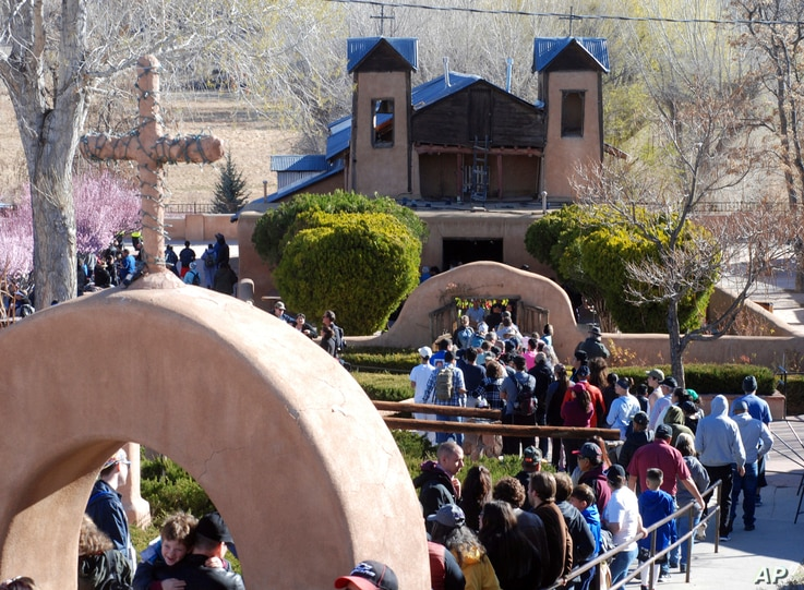 Thousands of Catholics traveled by foot to a small adobe church in Chimayo, New Mexico, March 30, 2018. The annual act of prayer, reflection and sacrifice attracts more than 20,000 people. Many set out before dawn and walk more than 30 miles (48 kilo...