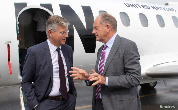 FILE - Jean-Pierre Lacroix, United Nations' under-secretary-general for peacekeeping operations, left, is received by David Shearer, head of the UN Mission in South Sudan (UNMISS), upon arriving in Juba, South Sudan, Aug. 1, 2017.