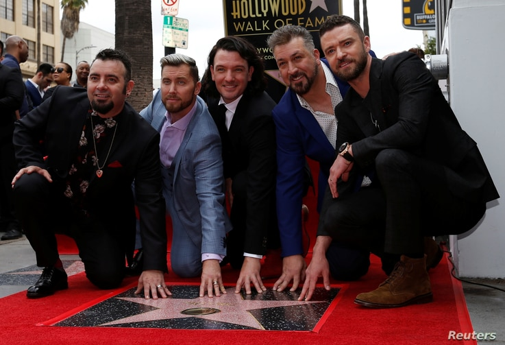 American boy band *NSYNC pose during the unveiling ceremony of their star on the Hollywood Walk of Fame in Los Angeles, April 30, 2018.