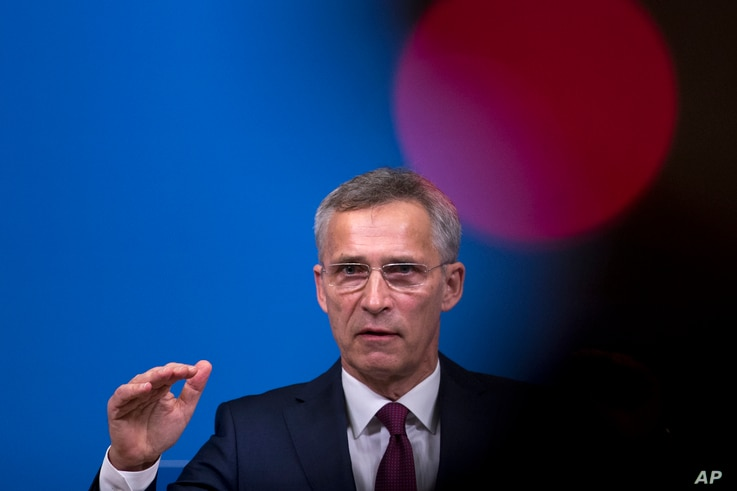 NATO Secretary General Jens Stoltenberg talks to journalists during a news conference at the NATO headquarters in Brussels, Oct. 24, 2018.