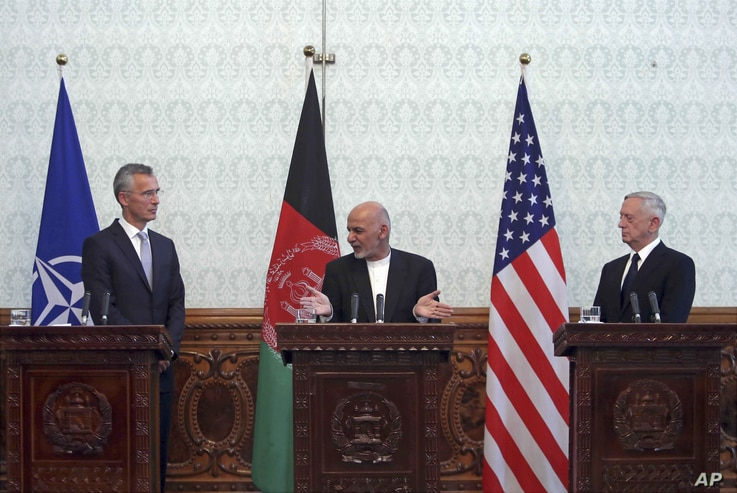 Afghan President Ashraf Ghani, center, speaks during a press conference with U.S. Defense Secretary Jim Mattis, right, and NATO Secretary General Jens Stoltenberg at the presidential palace in Kabul, Afghanistan, Sept. 27, 2017.