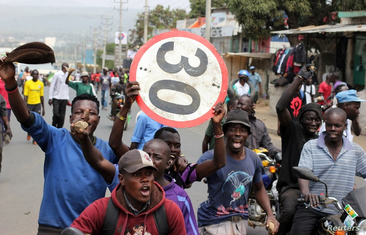 Supporters of Kenyan opposition leader Raila Odinga of the National Super Alliance (NASA) coalition protest against the treason charges on lawyer Miguna Miguna in the streets of Kisumu, Kenya, Feb. 6, 2018.