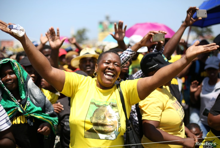 A supporter gestures during an address by African National Congress (ANC) President Cyril Ramaphosa during the Congress' 106th anniversary celebrations, in East London, South Africa, Jan. 13, 2018.