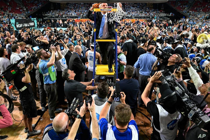 North Carolina coach Roy Williams helps cut down the net after the finals of the Final Four,  April 3, 2017, in Glendale, Arizona.