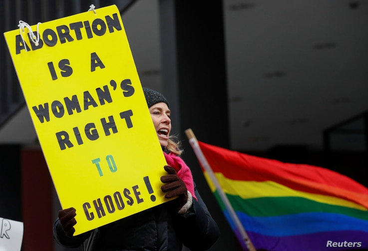 An anti-Trump demonstrator protests at an abortion rights rally in Chicago, Illinois, Jan. 15, 2017.